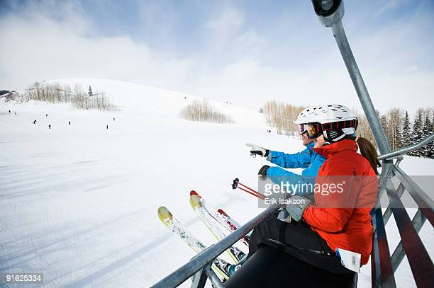 Skiers on a ski lift