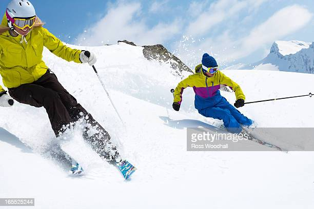 Skiers on snowy slope