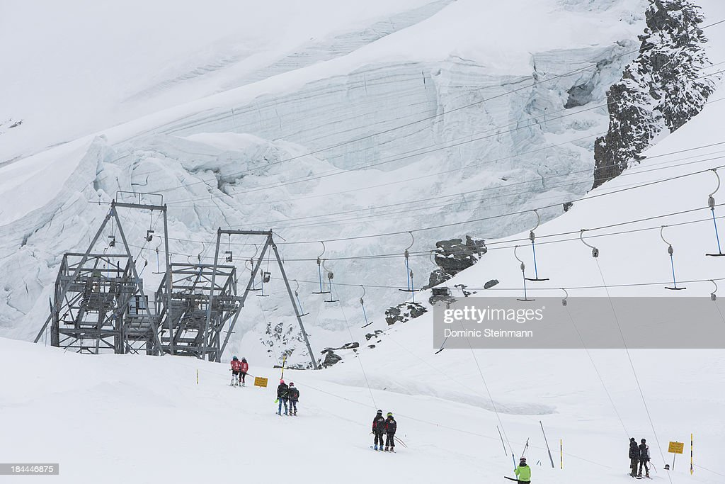 Skiers on the t-bar lift on September 16, 2013 in Saas-Fee, Switzerland.