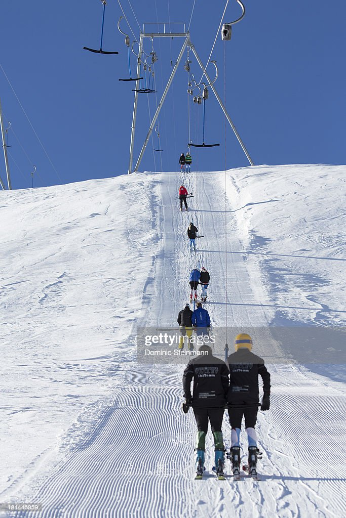 Skiers on the t-bar lift on the Fee glacier on September 13, 2013 in Saas-Fee, Switzerland.
