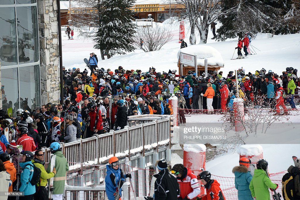 Skiers queue to take a ski lift on December 28, 2012, in the French Alps resort of Val-d'Isere. France's ski slopes are set to be busier than last year as early snow falls encourage higher bookings than last year, according to an industry spokesmen and a study released on December 18, 2012.