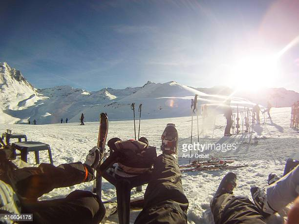 Skiers resting in restaurant after a descent in the snowy mountains in the French Alps France Europe