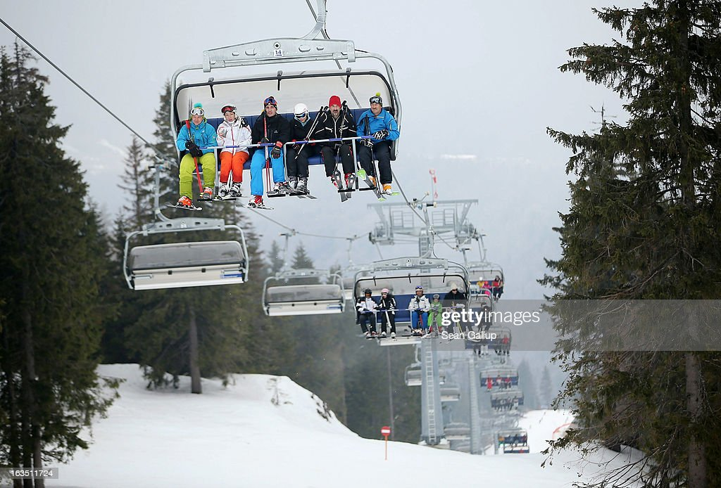 Skiers ride a chairlift at the Poiana Brasov ski resort in the Bucegi mountains on March 9, 2013 at Poiana Brasov, Romania. Romania is eager to promote its approximately 20 ski resorts, of which Poiana Brasov is among the biggest, to foreign tourists. Both Romania and Bulgaria have been members of the European Union since 2007 and restrictions on their citizens' right to work within the EU are scheduled to end by the end of this year. However Germany's interior minister announced recently that he would veto the two countries' entry into the Schengen Agreement, which would not affect labour rights but would prevent passport-free travel.