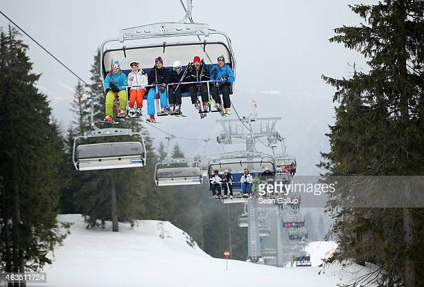 Skiers ride a chairlift at the Poiana Brasov ski resort in the Bucegi mountains on March 9 2013 at Poiana Brasov Romania Romania is eager to promote...
