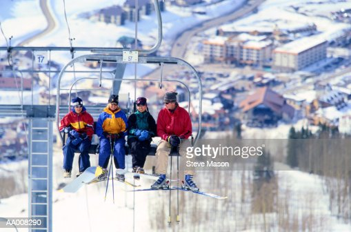 Skiers Riding on a Ski Lift