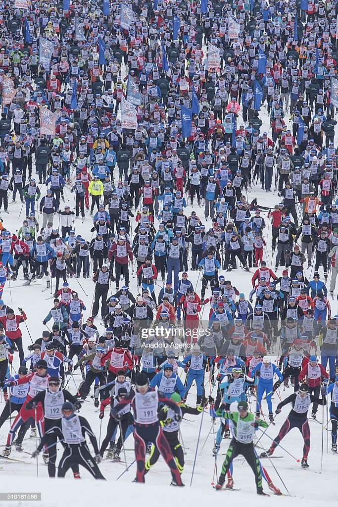 Skiers schuss during the all-Russian mass ski race 'Ski Track of Russia' at the basis of the Olympic training center 'Planernaya' in Khimki, Russia on February 14, 2016.