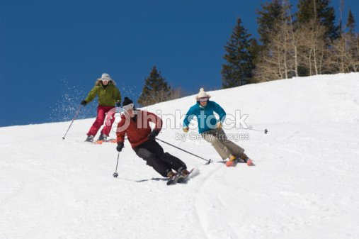 Skiers Skiing Down Slope : Stock Photo