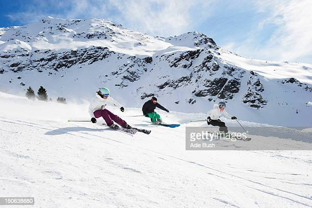 Skiers skiing together on slope