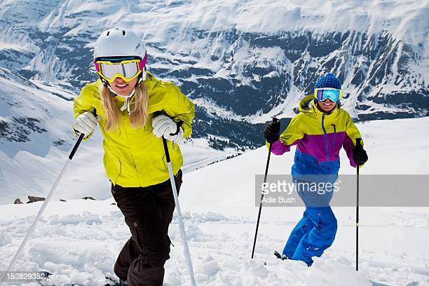 Skiers standing on snowy slope