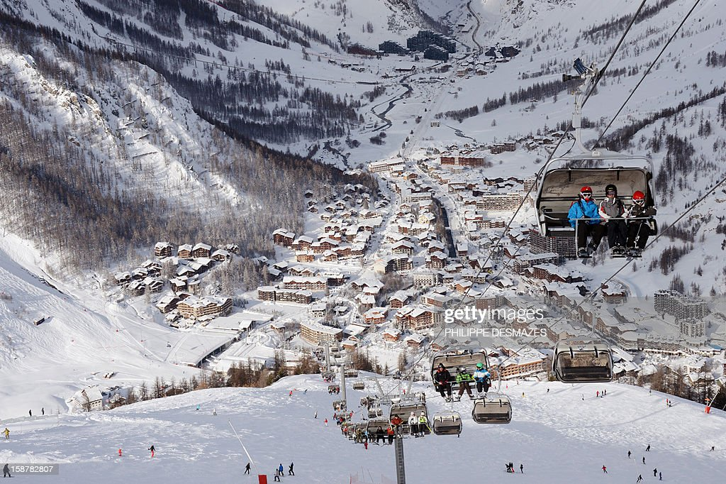 Skiers use a ski lift on December 28, 2012, in the French Alps resort of Val-d'Isere. France's ski slopes are set to be busier than last year as early snow falls encourage higher bookings than last year, according to an industry spokesmen and a study released on December 18, 2012.