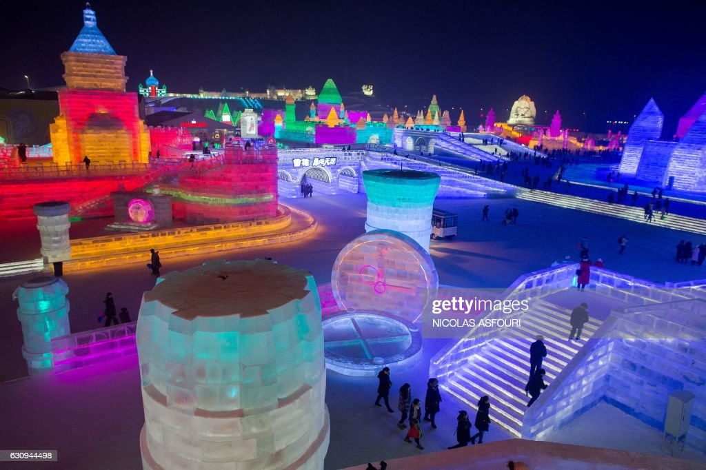People visit ice sculptures illuminated by coloured lights at the Harbin Ice and Snow Festival to celebrate the new year in Harbin on January 4, 2017. ASFOURI