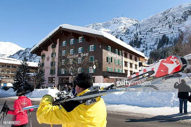 Skiers walk past Hotel Post the usual holiday residence of Queen Beatrix of The Netherlands and members of the Dutch royal family on February 17 2013...