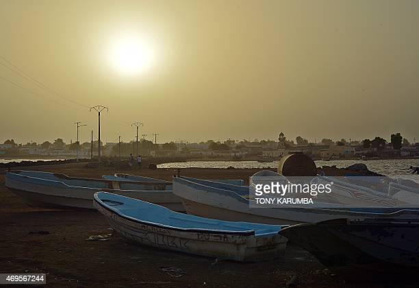 Skiffs sit on April 12 2015 on a beach in Obock a small port town in Djibouti located on the northern shore of the Gulf of Tadjoura where it opens...