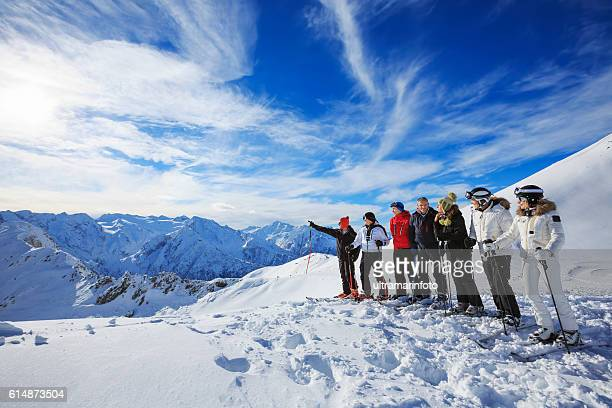 Skiiers group  enjoying sunny day on the top    Snow mountain