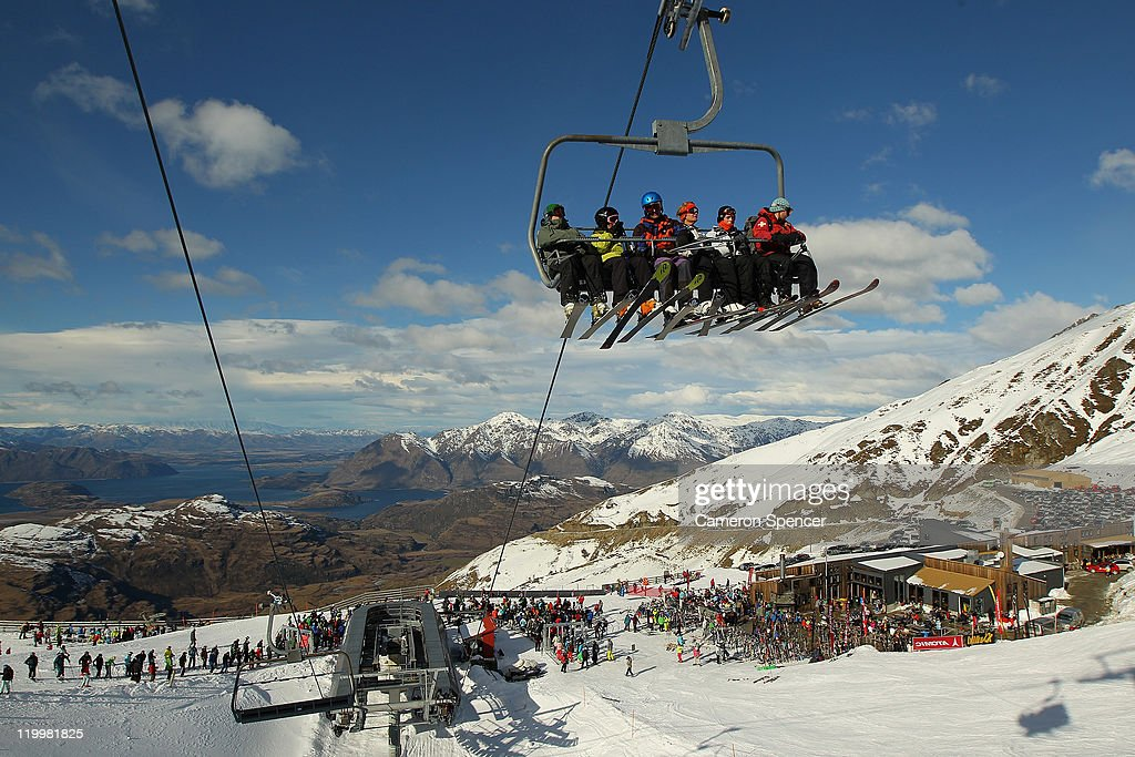 Skiiers ride a chairlift at Treble Cone ski resort on July 28, 2011 in Wanaka, New Zealand.