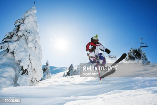 Skiing against clear blue sky.