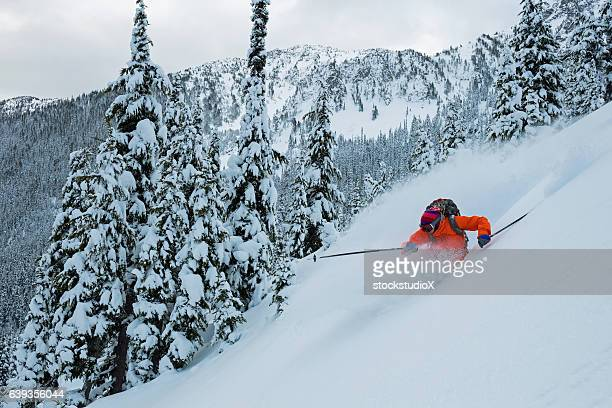 Skiing in deep powder through the trees
