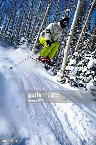 Skiing over a jump