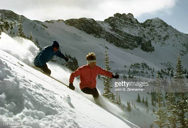 Scenic view of Ted Johnson and his wife Wilma Johnson in action at Alta Ski Area in Little Cottonwood Canyon of Wasatch Mountains Alta UT CREDIT John...