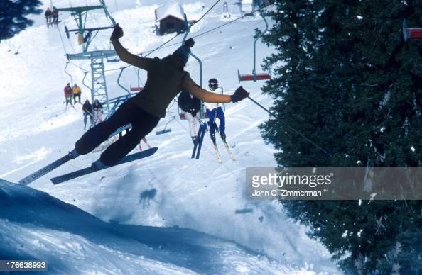 View of skiier jumping off of ski lift into Al's Run at Taos Ski Valley Taos County NM CREDIT John G Zimmerman
