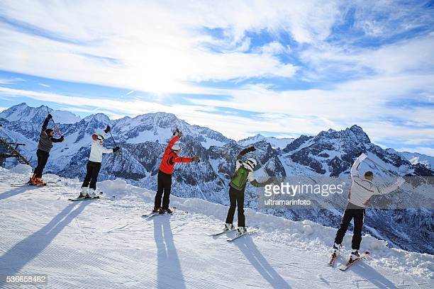 Skiing   Warm Up   Happy skier class on the mountain top