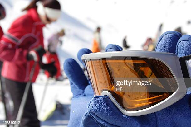 Skiing - Winter sport ski goggles in gloves close up
