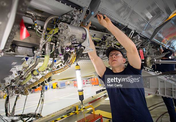 A skilled fitter works on the spoiler of a A400M at the Airbus aircraft manufacturer's Filton site on November 19 2015 in Bristol England The site at...