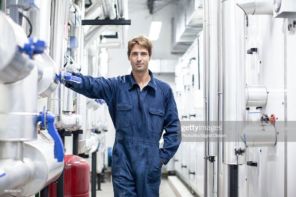 Skilled worker in industrial plant, portrait