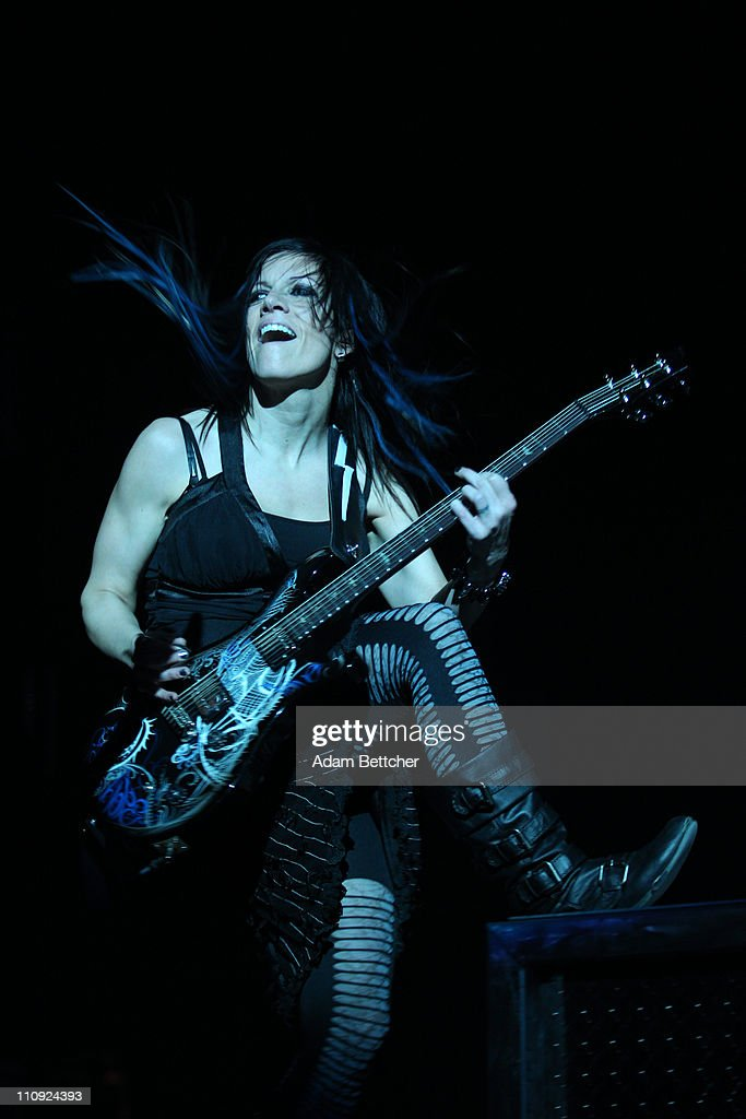 Skillet rhythm guitar and keyboardist Amy Cooper performs during the 2011 Avalanche Tour at the Roy Wilkins Auditorium on Saturday, March 26, 2011 in St. Paul, Minnesota.