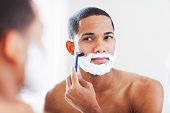 Young  African American man shaving. More files of this model and series on port.