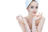 Skin care lady putting face cream / photos of attractive girl on white background