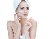 Skin care teenage girl putting face cream / photos of attractive girl on white background