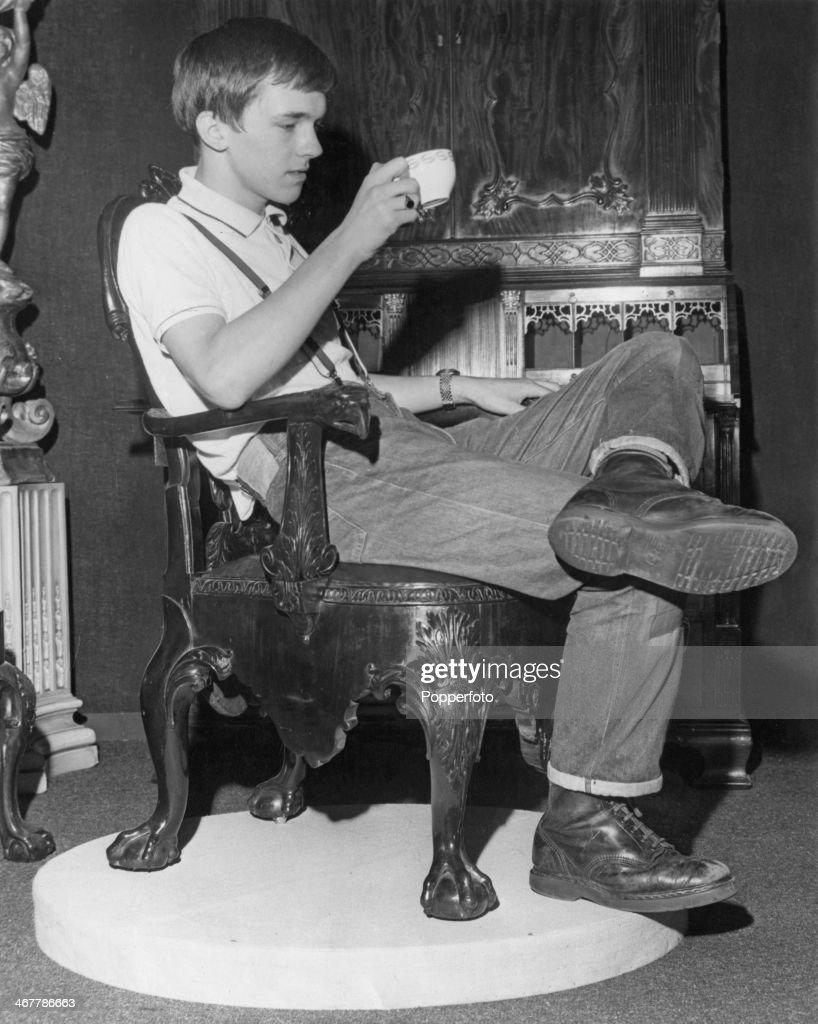 Skinhead Danny Osborne of Streatham takes a tea break in a Georgian chair during a day at work preparing the Antique Dealers' Fair at the Grosvenor...