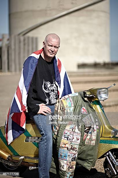 Skinhead on scooter with Union flag around him.