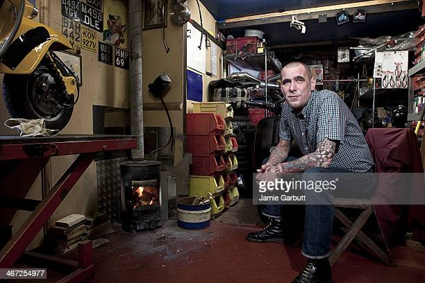 Skinhead sat in his shed with a wood burner