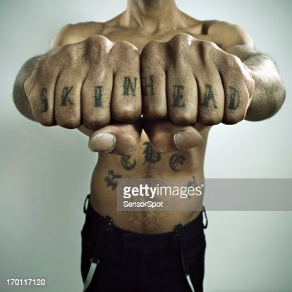 Skinhead Showing off Knuckle tattoo