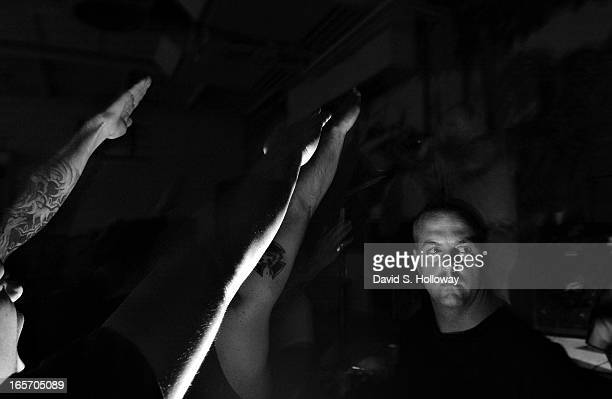 A skinhead works security during a Hammerskin concert held in the National Guard Armory on August 8 2002 in Towson Maryland The Hammerskins are the...