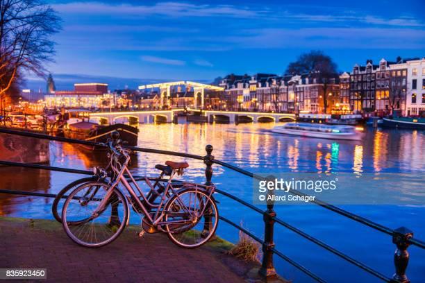 Skinny bridge and Amstel river in Amsterdam Netherlands at Dusk