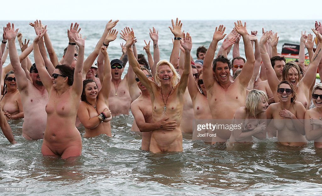 Skinny dippers in the water during an attempt to break the skinny dip world record at Papamoa Beach on December 2, 2012 in Tauranga, New Zealand.