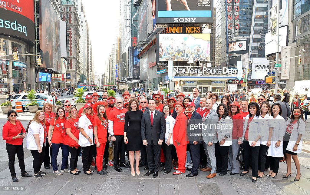 Skip Bourdo, Corporate Operations Vice President of Walgreens, Christy Gibb, Board of Trustees, Comic Relief, the non-profit behind Red Nose Day and guests visit The NASDAQ Opening Bell In Celebration Of Red Nose Day at NASDAQ MarketSite on May 26, 2016 in New York City.