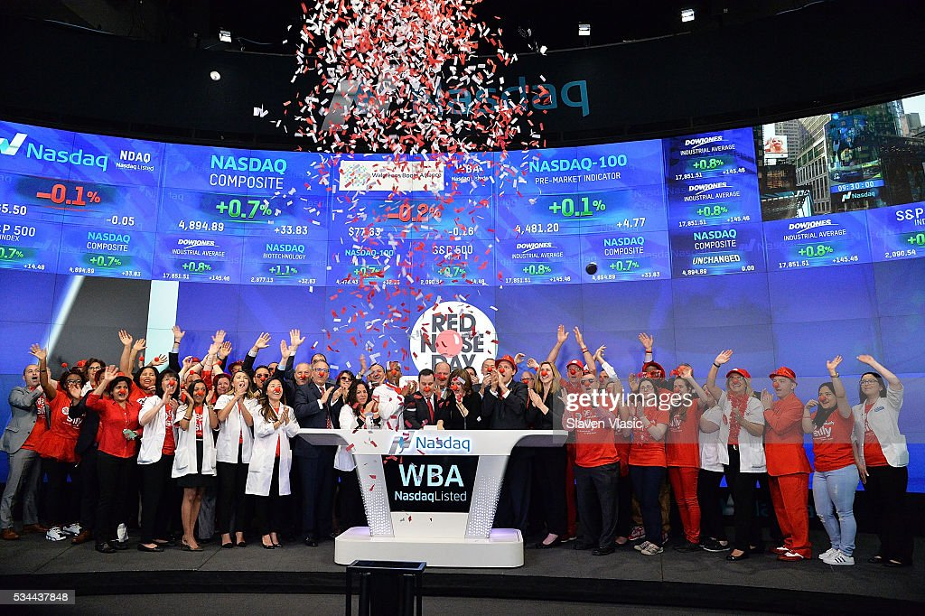 Skip Bourdo, Corporate Operations Vice President of Walgreens, Christy Gibb, Board of Trustees, Comic Relief, the non-profit behind Red Nose Day and guests ring The NASDAQ Opening Bell In Celebration Of Red Nose Day at NASDAQ MarketSite on May 26, 2016 in New York City.