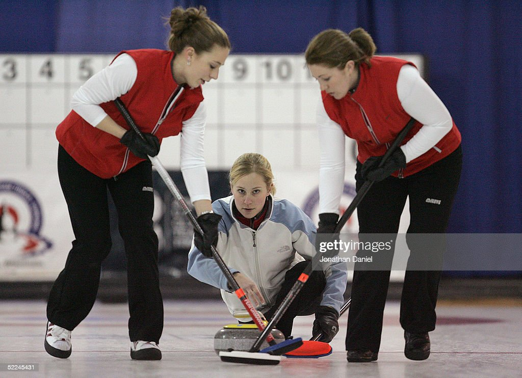 Skip Cassie Johnson watches the progress of the stone down the ice as teammates Jessica Schultz and Maureen Brunt prepare to sweep during the Women's...