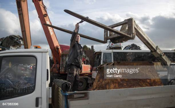 A skip is loaded onto a Transit van at Pylle Motor Spares and Metal Processing a licensed scrap yard in Pylle near Shepton Mallet on March 2 2017 in...
