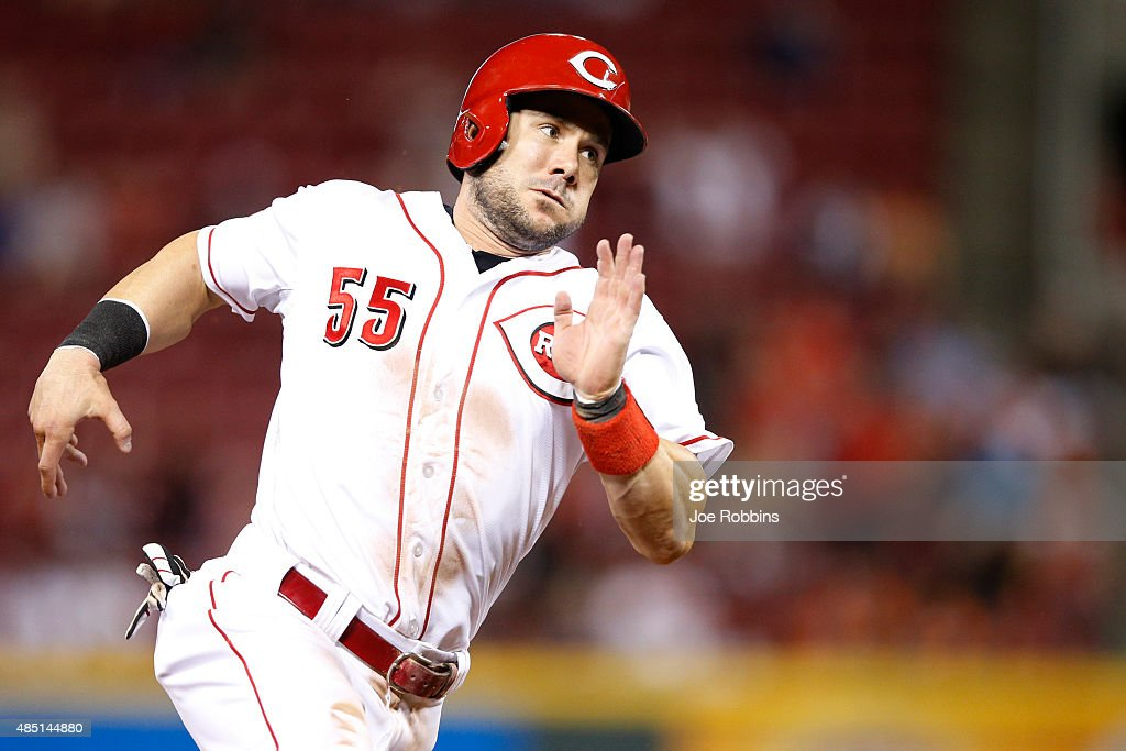 Skip Schumaker of the Cincinnati Reds comes around third to score on a tworun double by Eugenio Suarez in a tenrun sixth inning against the Detroit...