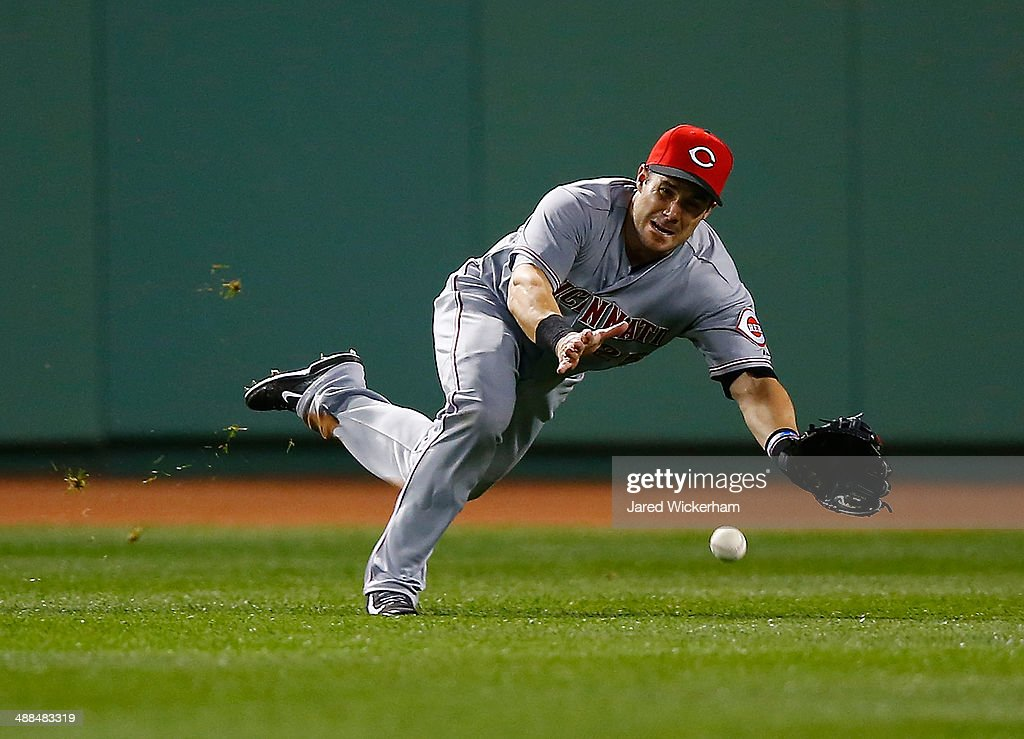 Skip Schumaker of the Cincinnati Reds comes up short on a fly ball into center field against the Boston Red Sox during the interleague game at Fenway...