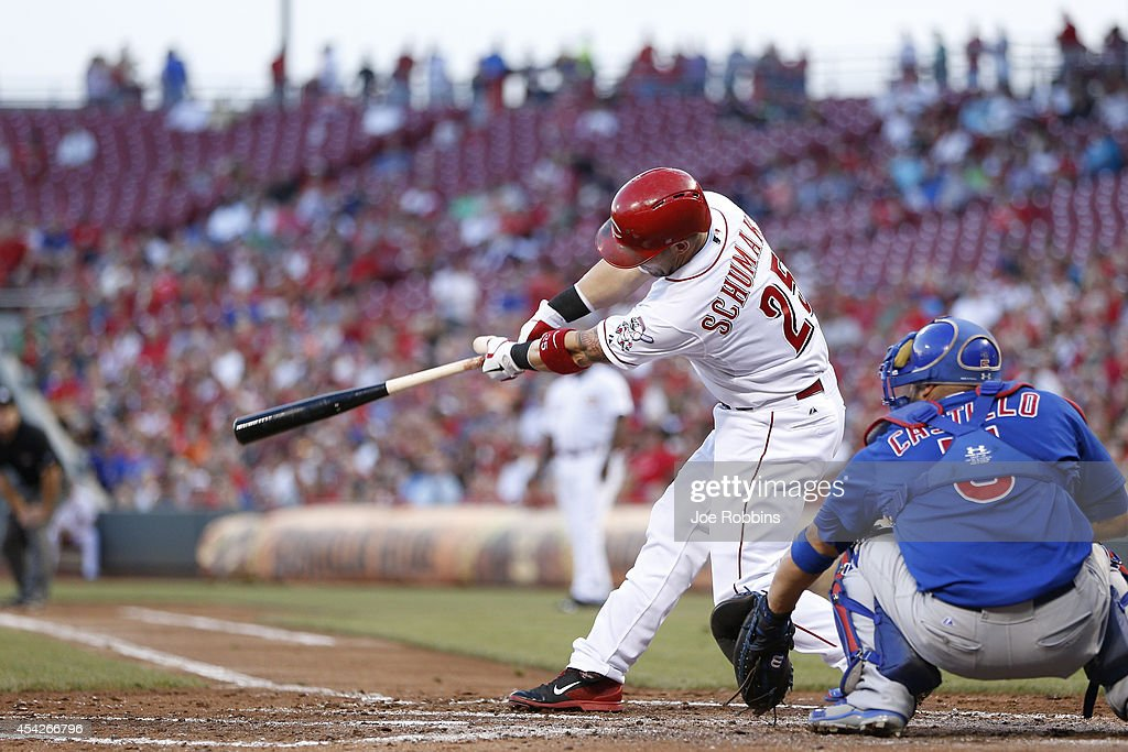 Skip Schumaker of the Cincinnati Reds drives in a run with a double in the second inning of the game against the Chicago Cubs at Great American Ball...