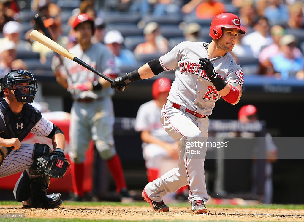 Skip Schumaker of the Cincinnati Reds drives in a run with adouble against the New York Yankees during their game at Yankee Stadium on July 19 2014...