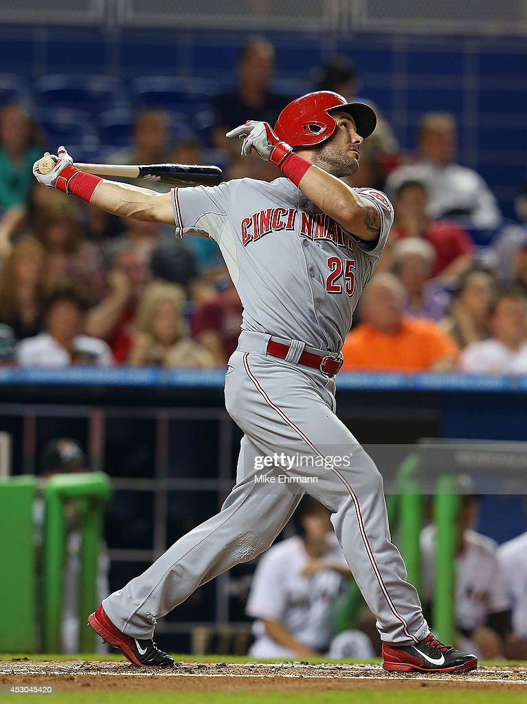 Skip Schumaker of the Cincinnati Reds hits during a game against the Miami Marlins at Marlins Park on August 1 2014 in Miami Florida