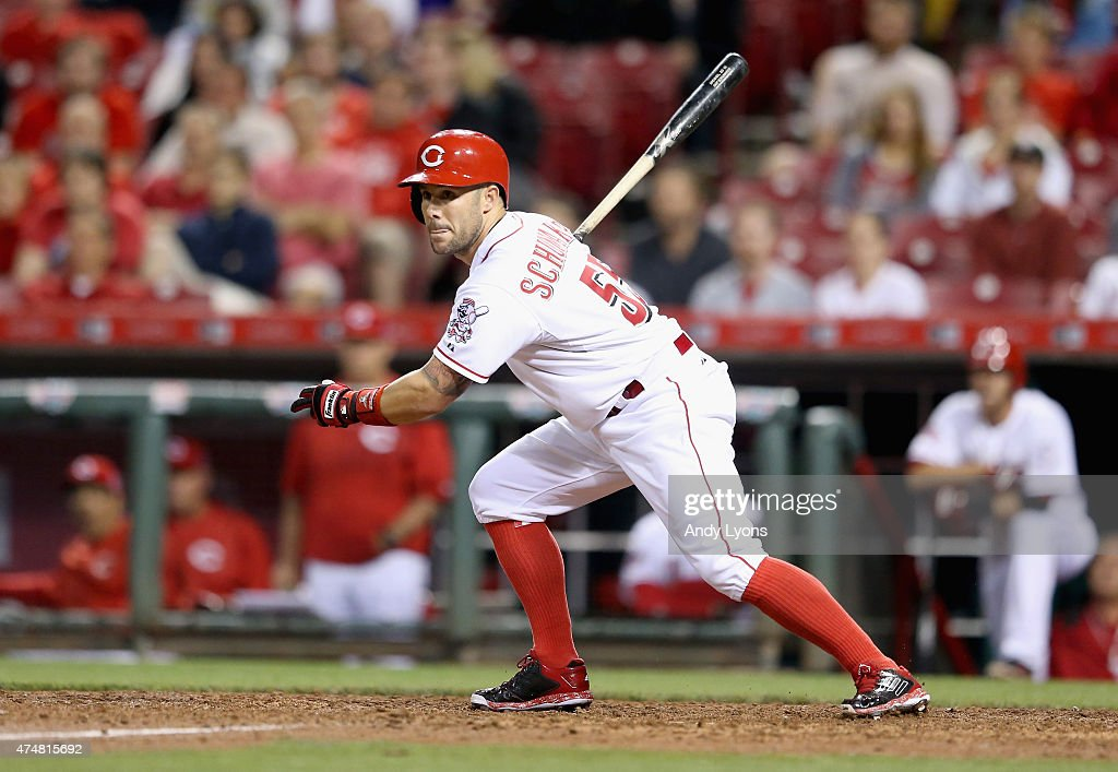 Skip Schumaker of the Cincinnati Reds hits the game winning RBI single in the 9th inning against the Colorado Rockies at Great American Ball Park on...