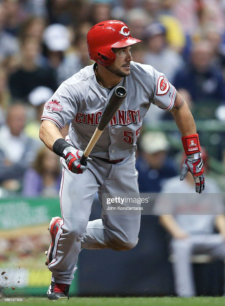 Skip Schumaker of the Cincinnati Reds runs out a ground ball during the fifth inning against the Milwaukee Brewers at Miller Park on August 29 2015...